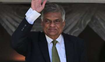ranil wickremesinghe vows to work with rivals to...