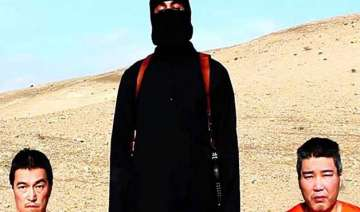 is threatens to kill 2 japanese hostages demands...