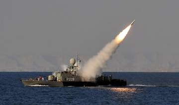 iranian navy test fires medium range surface to...