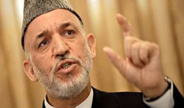 karzai arrives in pakistan on day long visit -...