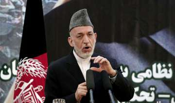karzai suspends talks with us over taliban move -...