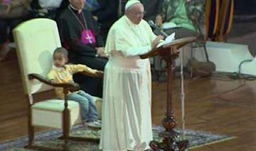 little boy sits in pope s chair steals the show -...