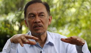 malaysian opposition leader anwar acquitted in...