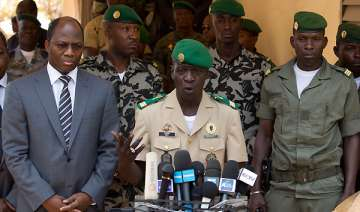 mali coup leader reinstates old constitution -...