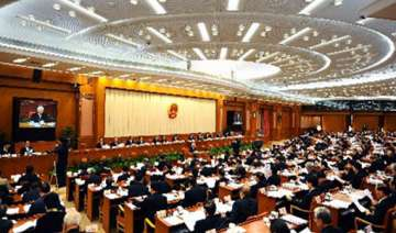 new china law targets foreigners working...