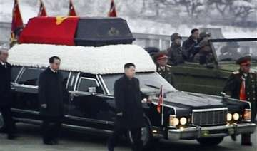 north korea bids wintry mass farewell to kim jong...