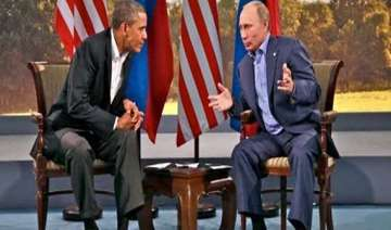 obama asks putin to withdraw forces from ukraine...