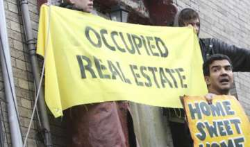 occupy protests move to foreclosed homes in us -...