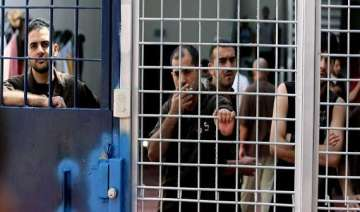 palestinian prisoners end hunger strike in...