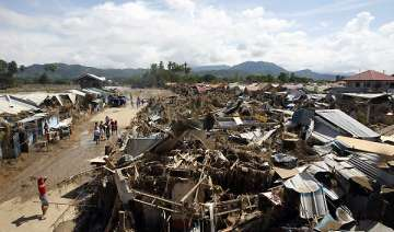 philippine floods death toll jumps to nearly 1...