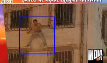 police abseil in to save suicidal man on window...