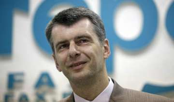 prokhorov russian tycoon to run against vladimir...