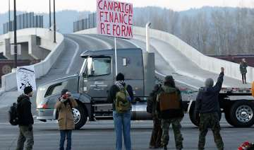 protesters halt operations at some western ports...