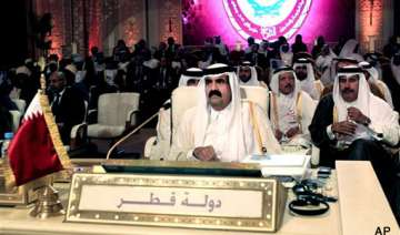 qatar ruler hands power to son to mark new era -...
