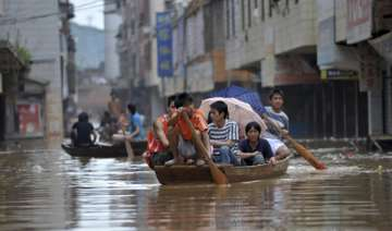 rescuers continue relief work in flood hit...