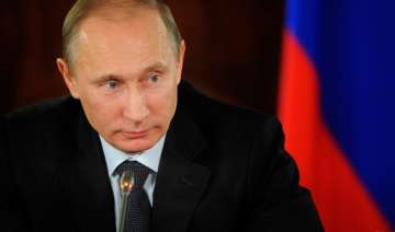 russia s poll body declares putin s party as...