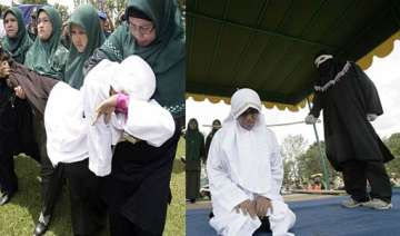 shariah police in indonesia gives 9 lashes to...