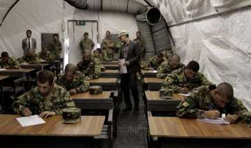 shocking half of afghan army is illiterate -...