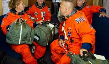 shuttle astronauts busy with space station...