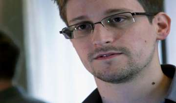 snowden missing julian assange says he is safe in...
