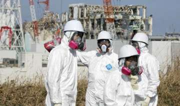 some 2 000 fukushima workers face increased...