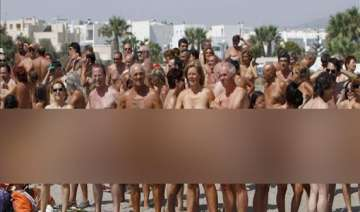 spanish town sets guinness record for most nude...