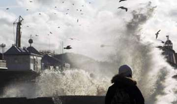 storms wreak havoc in britain leave two dead -...