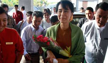 suu kyi registers party makes first parliament...