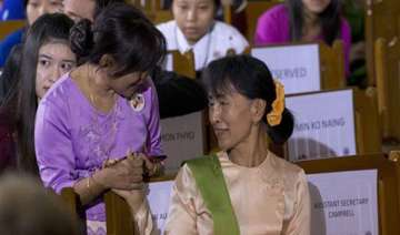 suu kyi condemns crackdown on protesters at...