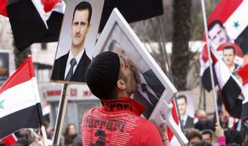 syria s assad makes rare appearance at rally -...