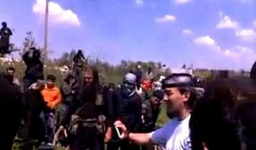 syrian video shows catholic priest beheaded by...