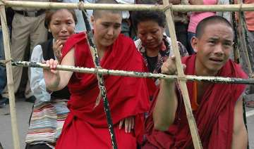 tibetan protests a reason for wen not coming to...