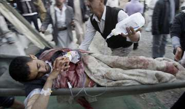 troops hit protesters marching into yemen capital...