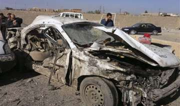 twin car bombs kill 11 in baghdad say police...
