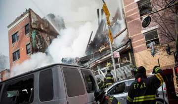 death toll in new york buildings collapse rises...