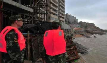 typhoon hits eastern china with strong winds rain...