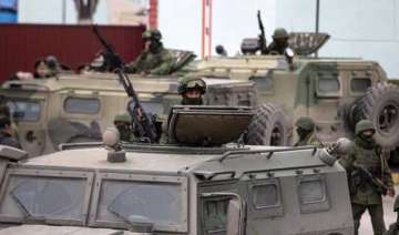 ukraine mobilizes army as west warns russia -...