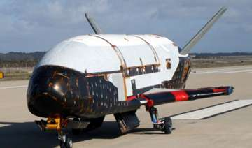 unmanned air force space plane lands in...