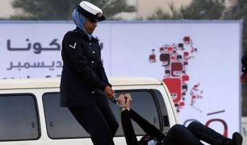 woman activist in bahrain handcuffed dragged hit...