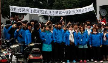 workers mass at shanghai factory in latest unrest...