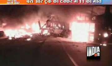 11 die in bus inferno after collision with truck...