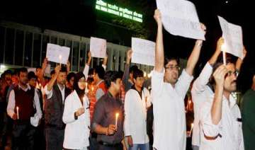 aiims resident doctors hold candle march - India...