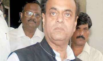 additional sp gives bouquet to sp leader abu azmi...