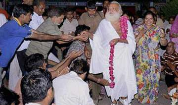 asaram employees fail to appear before police for...
