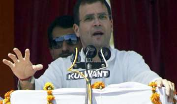 bjp brought khanduri to cover up scams says rahul...
