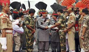 bsf pak rangers exchange eid sweets at wagah in...