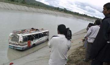 two killed over 40 feared drowned as bus falls...