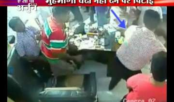 cctv footage of trinamool activists thrashing...