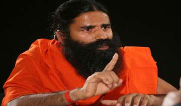 central excise officials raid ramdev s firms in...