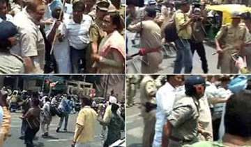 congress workers stage protests over rahul s...